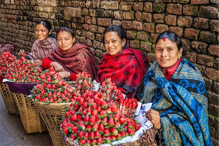 Nepali women selling strawberries on local market Stock Photo - Premium Royalty-Free, Code: 6106-08277780