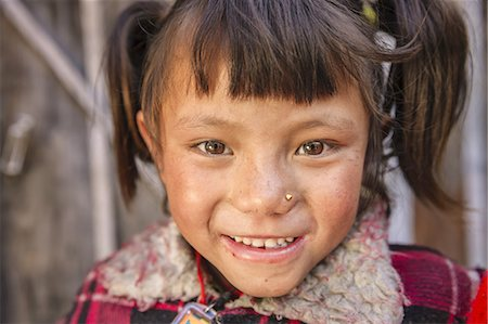 Young Nepali girl in Chame village Stock Photo - Premium Royalty-Free, Code: 6106-08277789
