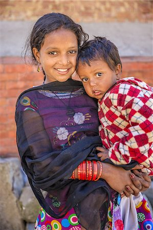 Young Nepali girl with her little brother Stock Photo - Premium Royalty-Free, Code: 6106-08277797