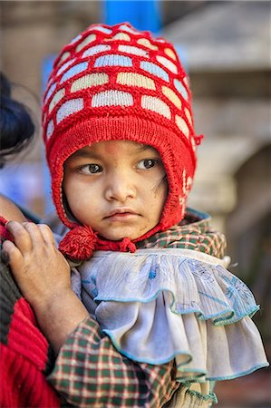 Nepali baby carrying by mother Stock Photo - Premium Royalty-Free, Code: 6106-08277853