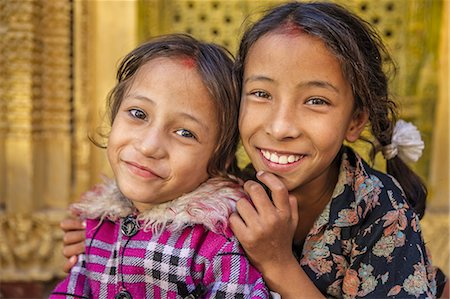 Two young Nepali girls resting in temple Stock Photo - Premium Royalty-Free, Code: 6106-08277854