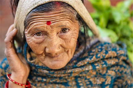 Nepali woman selling vegetables in Patan Stock Photo - Premium Royalty-Free, Code: 6106-08277838