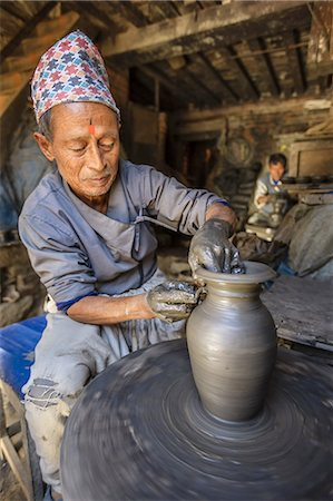 Nepali potter working in his workshop Stock Photo - Premium Royalty-Free, Code: 6106-08277977