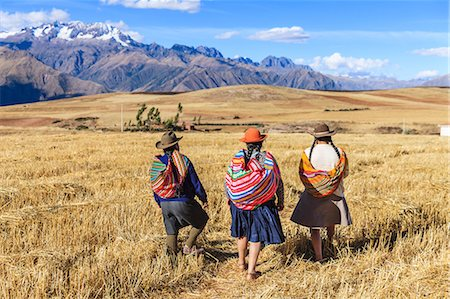 Peruvian women crossing field, Andes on background Stock Photo - Premium Royalty-Free, Code: 6106-08278350