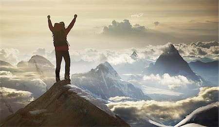extreme terrain - Climber standing on a mountain summit Stock Photo - Premium Royalty-Free, Code: 6106-08278475