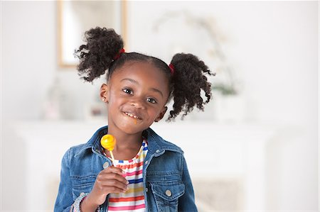 girl with lollipop Stock Photo - Premium Royalty-Free, Code: 6106-08226240