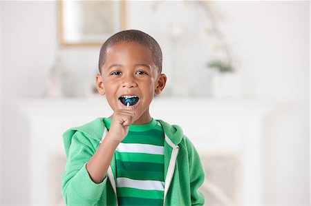 boy with lollipop Stock Photo - Premium Royalty-Free, Code: 6106-08226242