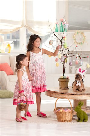 girls with easter tree Stock Photo - Premium Royalty-Free, Code: 6106-08350712