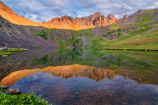 Clear Lake and paintbrush Stock Photo - Premium Royalty-Free, Image code: 6106-08351082