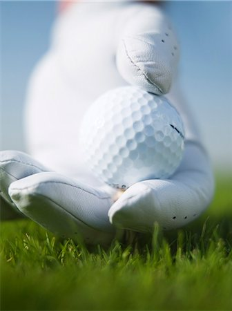 Golf ball onto tee Stock Photo - Premium Royalty-Free, Code: 6106-08387864