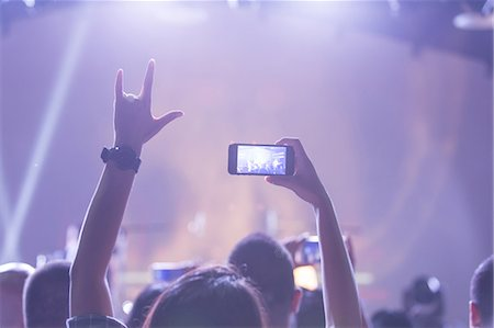 Crowd using smart phone at rock concert Stock Photo - Premium Royalty-Free, Code: 6106-08480382