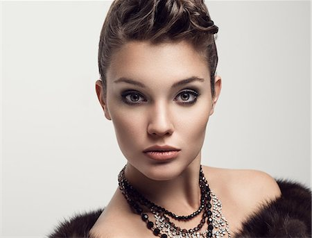 female - Attractive fashion model posing in fur Stock Photo - Premium Royalty-Free, Code: 6106-08480396