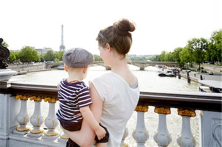 Mom and toddler boy in Paris facing Eiffel Tower Stock Photo - Premium Royalty-Free, Code: 6106-08480457
