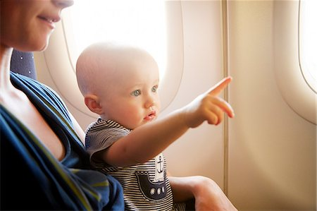 Baby on airplane pointing Stock Photo - Premium Royalty-Free, Code: 6106-08480456