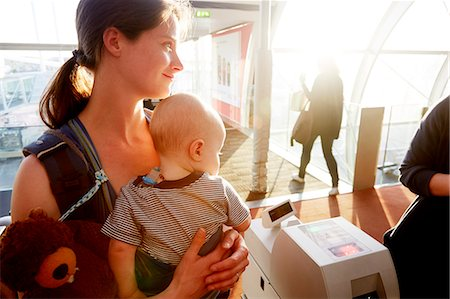 Mother and baby at gate check at airport Stock Photo - Premium Royalty-Free, Code: 6106-08480468
