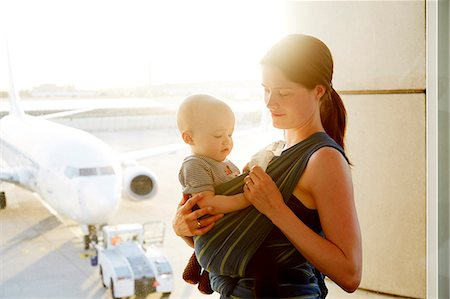 Mom with baby at airport Stock Photo - Premium Royalty-Free, Code: 6106-08480484