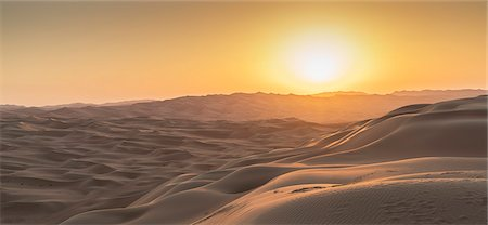 scenic - Sand dunes in the desert at sunset Stock Photo - Premium Royalty-Free, Code: 6106-08549460