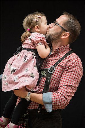 Father and Daughter Traditional Bavarian Lederhose Stock Photo - Premium Royalty-Free, Code: 6106-08549554