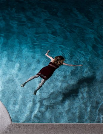 dead woman - Woman Lying Dead in a Swimming Pool Stock Photo - Premium Royalty-Free, Code: 6106-08549563