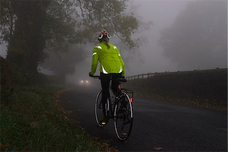 Cyclist in high visibility safety wear on the road Stock Photo - Premium Royalty-Free, Code: 6106-08509110