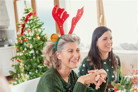 Mature woman with Christmas funny hat Stock Photo - Premium Royalty-Free, Code: 6106-08509137