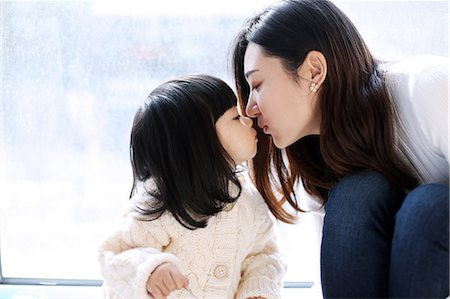 daughter kissing mother - kissing daughter Stock Photo - Premium Royalty-Free, Code: 6106-08520302