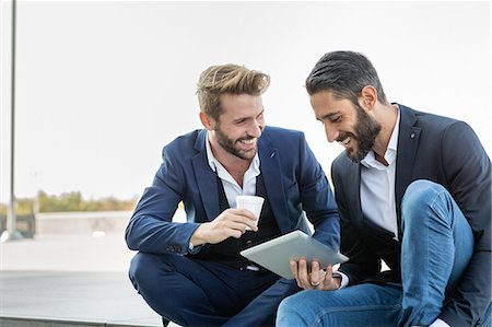 businessmen with tablet during working break Stock Photo - Premium Royalty-Free, Code: 6106-08527522