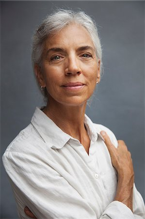 A middle aged female wearing a white shirt Stock Photo - Premium Royalty-Free, Code: 6106-08684658