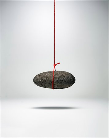 string - Pebble hanging on a string Stock Photo - Premium Royalty-Free, Code: 6106-08634304