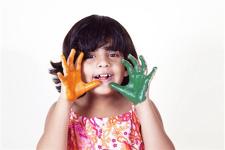 Portrait of a young girl with colored palms Stock Photo - Premium Royalty-Free, Code: 6107-06117573