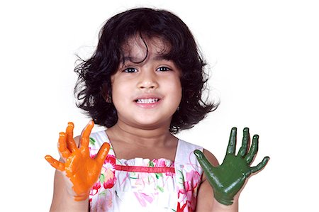 Portrait of a young girl with colored palms Stock Photo - Premium Royalty-Free, Code: 6107-06117574