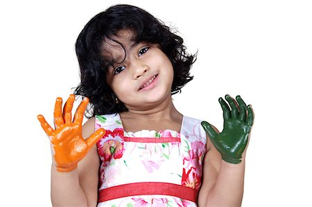 Portrait of a young girl with colored palms Stock Photo - Premium Royalty-Free, Code: 6107-06117575