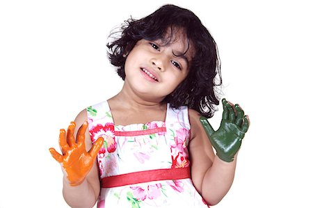 Portrait of a young girl with colored palms Stock Photo - Premium Royalty-Free, Code: 6107-06117576