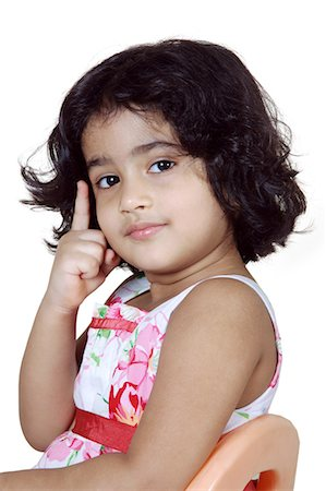 Portrait of a young girl posing Stock Photo - Premium Royalty-Free, Code: 6107-06117578
