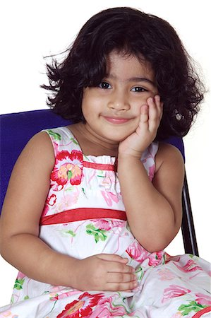 Close-up of a young girl smiling Stock Photo - Premium Royalty-Free, Code: 6107-06117579