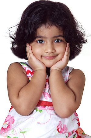 Close-up of a young girl smiling Stock Photo - Premium Royalty-Free, Code: 6107-06117580