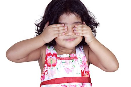 Portrait of a young girl covering her eyes with her hands Stock Photo - Premium Royalty-Free, Code: 6107-06117581