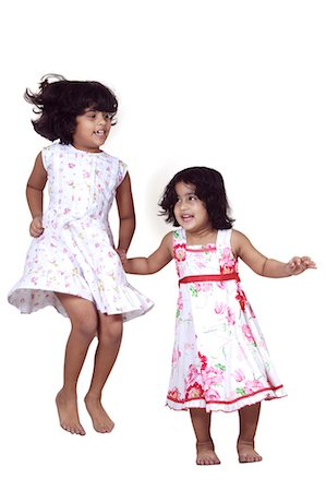 Portrait of young girls jumping Stock Photo - Premium Royalty-Free, Code: 6107-06117587