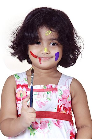 Portrait of a girl with paint brush Stock Photo - Premium Royalty-Free, Code: 6107-06117588