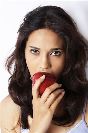 right - Close-up of a young woman eating red apple Stock Photo - Premium Royalty-Free, Code: 6107-06117500