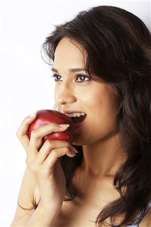right - Close-up of a young woman eating red apple Stock Photo - Premium Royalty-Free, Code: 6107-06117501