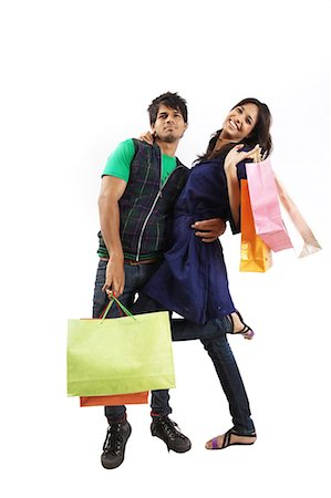funky - Young couple posing with shopping bags Stock Photo - Premium Royalty-Free, Code: 6107-06117516