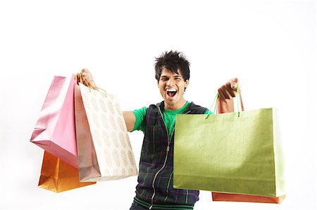 funky - Portrait of a young man posing with shopping bags Stock Photo - Premium Royalty-Free, Code: 6107-06117530