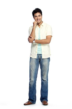 Portrait of young smiling man posing Stock Photo - Premium Royalty-Free, Code: 6107-06117647