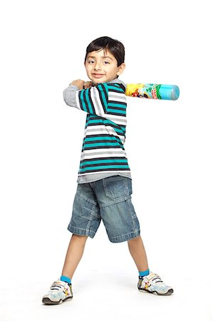 Portrait of little boy with baseball bat Stock Photo - Premium Royalty-Free, Code: 6107-06117680