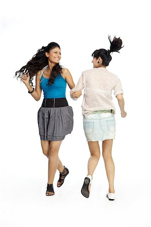 young women playing holding hands Stock Photo - Premium Royalty-Free, Code: 6107-06117888