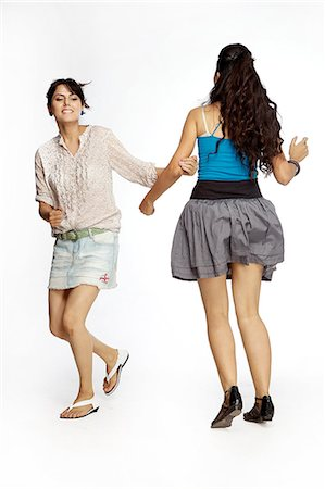 young women playing holding hands Stock Photo - Premium Royalty-Free, Code: 6107-06117889