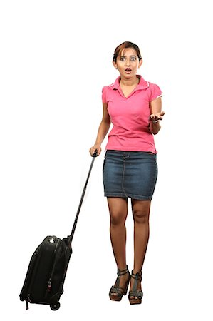 Portrait of young woman with rolling suitcase Stock Photo - Premium Royalty-Free, Code: 6107-06118102