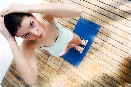slim - Woman on scales Stock Photo - Premium Royalty-Free, Code: 6108-05855674
