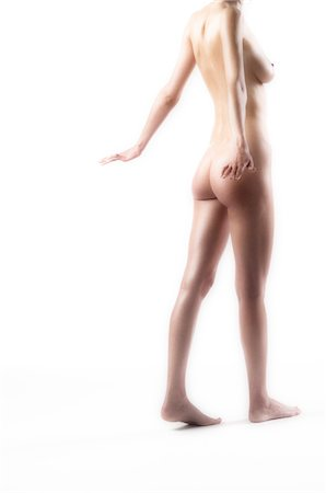 Naked woman walking, view from the back (studio) Stock Photo - Premium Royalty-Free, Code: 6108-05855851